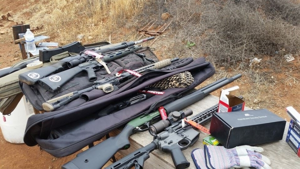 Firearms at the range using Plug'r chamber flags as empty chamber indicators.